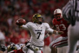 #7 Cody Hawkins (cq) of Colorado is sacked by #43 Ty Steinkuhler (cq) of Nebraska during the 2nd...