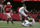#3 Jimmy Smith (cq) of Colorado tackles #17 Todd Peterson (cq) of Nebraska during the 2nd half of...