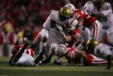 #1 Josh Smith (cq) of Colorado is swarmed by a group of Nebraska defenders during the 2nd half of...