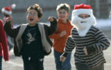 0588 Third grader Jacob Burnett, 9, joins in a  Jingle Bell Run to raise money and to support the...