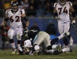 JPM519  Carolina Panthers Jon Beason lands on Denver Broncos Jay Cutler (6) after Cutler scrambled...