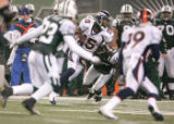 0891 Denver Broncos wide receiver Brandon Marshall (15) makes a first down catch in the second...