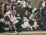 0603 Denver Broncos wide receiver Eddie Royal (19) shakes off New York Jets safety Abram Elam (27)...