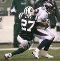 1329 Denver Broncos tight end Tony Scheffler (88) is tackled by New York Jets safety Abram Elam...