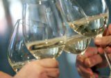 Employees at the Oceanaire Seafood Room in Denver toast with white wine before trying Chef Matt...