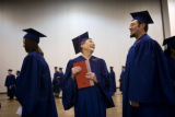 Winifred Jennings, 85, (cq) laughs with Vassili Khristoforov, 29, (cq) before their graduation...