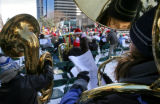 (at right) 24 year-old Heather Dennis (cq), from Loveland, plays her tuba at the annual Tuba...