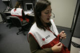 Staff member of the American Red Cross Katherine Streker (cq) makes phone calls for the American...