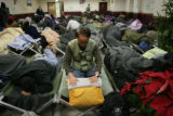 George Mason (cq) prepares his bedding at The Denver Rescue Mission, Lawrence Street, 1130 Park...