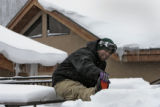 Mikael Guillory (cq), from Wheatridge, stretches before going snowboarding,  Loveland Basin...