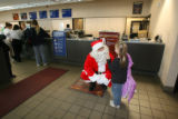 Santa Claus ( Pat Reynolds- cq) talks to 6 year old Margaret Nass,Tuesday morning, December 2,...