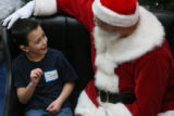 MJM206  Andru Jackson, 4, of Mountain View Elementary of Broomfield signs to Signing Santa as...