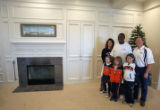 NFL Rookie of the Year candidate Eddie Royal (cq) takes a family portrait with the Swift family,...