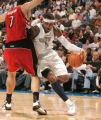 0101Denver Nuggets forward Carmelo Anthony (15) drives around Toronto Raptors forward Andrea...