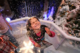 MJM670  Vanessa Rodriguez, 6, of Mountain View Elementary of Longmont, Colo. plays in fake snow...