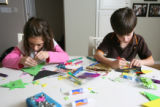 Twins Rebecca (left) and Casey Zickerman make Christmas tree ornaments at their home in Lowry on...