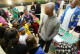 (0232) Denver Nugget Chauncey Billups is surrounded by kids as he gives away toys for Christmas to...