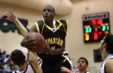 (PG322) Thomas Jefferson's Ray Riley goes up for a shot against ThunderRidge on Tuesday, December...