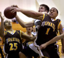 (PG593) Players scramble for a rebound during the Tip-Off Classic at ThunderRidge on Tuesday,...