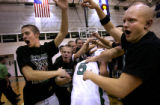 (PG632) ThunderRidge fans form a tunnel for players as they leave the court after winning on...