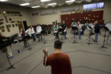DM3305  Percussion instructor Shilo Stroman leads the drummers in the Windsor High School band...