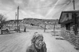 89 year-old Alice Begay stands next to her sister's home in New Mexico. Her whole family lived in...
