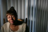 Deborah Richardson cries as she thinks about what happened to hert in Denver, Colo. Wednesday,...
