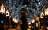 (0151) A woman walks past Christmas decorations on the 16th street mall in Denver., Colo., on...