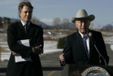 SOI  Chief of Staff, Tom Strickland,  listens as Secretary of the Interior, Ken Salazar  addresses...