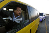 Cab driver, Fetseme Gebremariam (cq) waits in the taxi staging area at DIA Thursday January 29,...