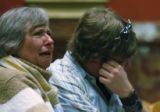 Stepmother Carol Johnson and brother Adam Johnson of Lauren Johnson show their emotion during...
