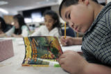 Jose Avina,10, a 4th grader works on his homework after school at Columbine Elementary School in...