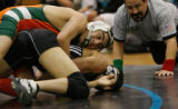 In Class 5A non-league wrestling in the 130 wt Adams City Eagle's Aaron Ortiz has  Westminster's...