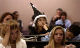 Tenth grader Jessica Ruiz (cq), middle with hat, from Company B, watches presentations for new a...