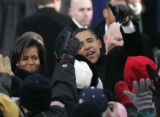 (184) President-Elect Barack Obama and Michelle Obama waves to supporters at a crowd estimated at...