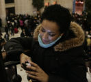 JPM0049 Karim Rios, of Washington, D.C., checks her mobile phone in Union Station in Washington,...