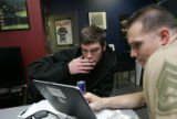 (0293) Recruit Mark Sabatino (cq), 22, left, looks over his information with Marine Recruiter...