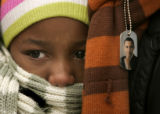 (1037) Bundled up to stay warm, Ranoah Johnson (cq), 8, waits for President-Elect Barack Obama to...