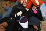 MJM346 A group of American University students huddle up for warmth as thousands of people turned...