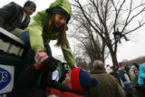 MJM586 Kelsey Yoder (cq), of Oregon is helped down from a portable toilet by Joshua Schumate (cq)...