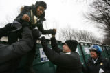 MJM596 U.S. Park authorities help a woman down from on top of a porta toilet after people were...