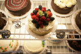 Cakes sit in a refrigerator at Indulge Bakery 1377 Forest Park Circle in Lafayette, Colorado on...