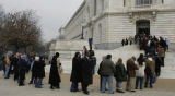 JOE0201 A line of people stretches down the block from the Senate's Russell office building on ...