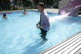 Denver Mayor John Hickenlooper could not wait to join local children as they break in the new 100,...