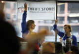 SR(228) At left, a volunteer, Jennie Mayeux, 48, of Denver, holds up her hand signaling a number...