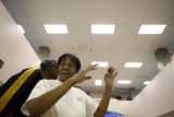 SR(326) A Denver resident, Jackie Morrow, 62, dances to sound of live jazz music after a free...