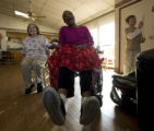 At Woodridge Terrace Nursing Home, Larry Rucker-Brown reacts to hitting a good run with fellow...