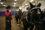 Scott Smith (cq) of Weatherford, Texas (left) looks over his six horse hitch before riding at the...