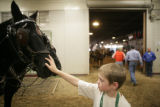 Tate Lantz, 9, (cq) of Watkins pets Jubal, 29, (cq). Scott Smith (cq) of Weatherford, Texas drives...