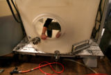 (PG11510) Winemaker Michelle Cleveland cleans a tank while filtering red and white wines at...
